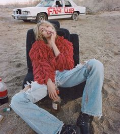 Red fake furr - flare jeans outfit