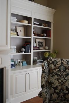 This is what our cabinets will look like next to our fireplace! Love the gray on the back wall