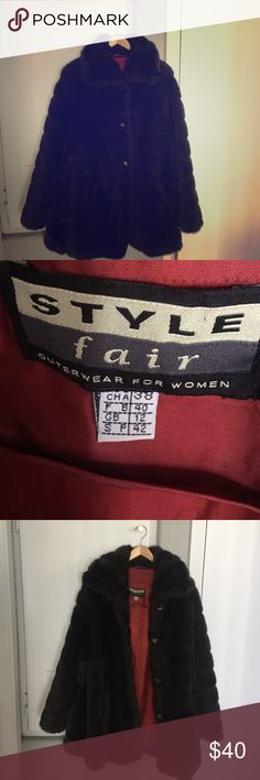 Faux fur Coat vintage brown faux fur coat. Burgundy lining . sleeves are strechy at wirst. mid length. Jackets & Coats