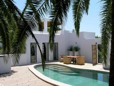 Search our hand-picked Boutique Hotels, Apartments & Villas Mediterranean Houses, Style Ibiza, Mid Century Exterior, African House, Outdoor Living Rooms, Ibiza Fashion, Spanish House, Villa Design, Pool Designs