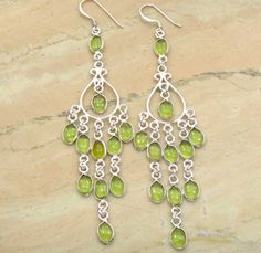 Browse must have drop earrings & dangle earrings for girls at SterlingSilverJewelry.tv, Shop at the latest in drop & dangle handmade earrings designs and style and complete your look. Buy Genuine Peridot Dangle Hook Solid 925 Sterling Silver Earrings at best wholesale price. Click to buy! #WholesalePeridotDangleHookEarrings #SterlingSilverGemstoneDangleEarringsSupplier #SterlingSilverDangleEarringsWholesaler #SterlingSilverJewelryManufacturer #IndianSterlingSilverJewelrySupplier…