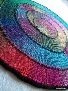 Hand knitted spiral blanket