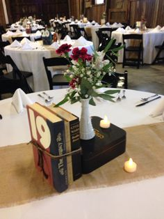 Love the use of books for table numbers !