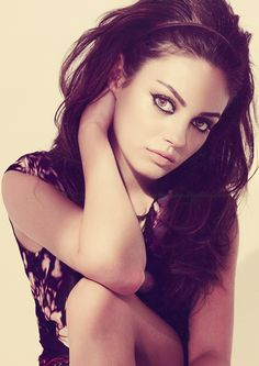 Mila Kunis. Cat eye and Love the hair!