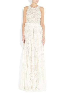 Lace has always been a beautiful bridal choice, and Lanvin has taken the tradition to exquisite new heights with this tulle-trimmed ivory gown. Flattering ruching will focus attention on your waist, while creating an elegant fullness in the skirt