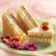 Mouthwatering flavor and festive color come from the ribbons of filling in these appetizer sandwiches. Egg salad and an olive-nut blend pair beautifully in these delicate teatime treats. Tea Party Sandwiches, Appetizer Sandwiches, Finger Sandwiches, Appetizers, Appetizer Ideas, Tea Recipes, Snack Recipes, Snacks, Savoury Recipes