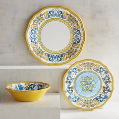 """Inspired by Italian art that dates back to the Renaissance, our shatter-resistant melamine plates will make your outdoor party feel like a Tuscan picnic. Alternating royal blue and yellow scrolls come full circle to give you a presentation that will have your dinner guests shouting, <i>""""Bellissimo!""""</i>"""