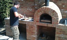 Testing a recently constructed pizza oven, good work if you can get it :)