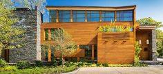 Contemporary three-storey residence situated on a wooded site in Bethesda, Maryland, United States. It was designed by Dynerman Architects