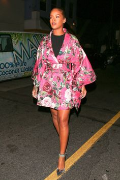 24 of the baddest of bad gal looks, Rihanna style: add a bit of fun with a short floral kimono and metallic pumps.