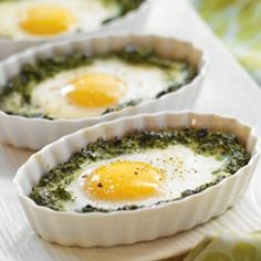 Baked Eggs & Spinach | 300 g frozen spinach, thawed and drained, 1 tbsp canola oil, 1 small onion, finely chopped, 125 ml Cream Cheese, 1/4 tsp ground nutmeg, 4 Eggs - Large, 1/8 tsp sea salt, 1/8 tsp freshly ground black pepper