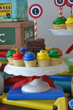 Brownies and cupcakes in primary colors on a Back To School window display for Bake Sale. Styling by Sweet Design Company.