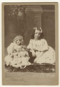 This cabinet card portrait features a sweet little girl posing as she sits of an animal skin rug with her three bisque dolls. Interestingly, the dolls have similar faces but are three different siz… Vintage Children Photos, Vintage Girls, Vintage Pictures, Vintage Images, Vintage Art, Little Girl Poses, Little Girls, Beautiful Children, Beautiful Dolls