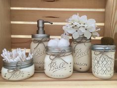 A perfect gift for him or her to add a little country, farmhouse charm to your bath! Choose your own unique color scheme and organize the set to fit your needs! This 5 piece Ball Mason Jar Bath Set is hand painted, distressed and sealed with a matte sealant to match your bathroom in the color of your choice! The set includes one pint size Mason Jar Soap Dispenser for your choice of soap, lotion, sanitizer, etc. with a stainless steel pump and 4 assorted jar sizes in half pint, pint size…