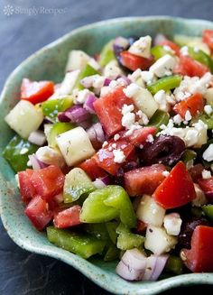 Dad's Greek Salad ~ Classic Greek salad recipe, with plum tomatoes, cucumber, red onion, bell pepper, black olives, and crumbled feta cheese.  Served with a red wine vinegar vinaigrette. ~ SimplyRecipes.com