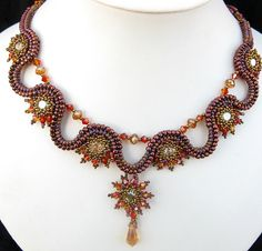 Love the undulating band in this Phoenix Rising Necklace by Cielo Design, via Flickr #afs collection
