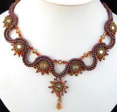 Phoenix Rising Necklace by Cielo Design, via Flickr