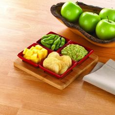 Appetizers, snacks and more will be the hit of your party when you set them in this fantastic serving tray. The bamboo platter features four indentations for the included square red ceramic dishes that you can fill with your favorite bites. Let the party begin in style!