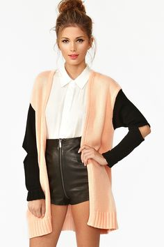 leather shorts, white blouse, oversized cardi