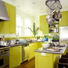 A helpful site when choosing kitchen color schemes... I'm liking this green.