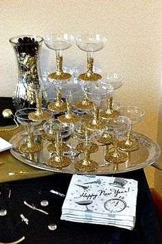 NYE Champagne Glass Presentation - Easy DIY plastic glasses decoupaged with glitter on the base and stems. A great New Years Eve or Christmas accent.
