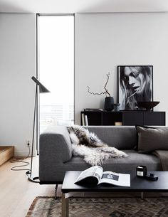 AJ floor lamp by Arne Jacobsen from Louis Poulsen, Delphi sofa by Hannes Wettstein from Erik Jørgensen and Montana storage by Peter J. Lassen from Montana Furniture