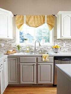 This kitchen's new backsplash helps unite two different cabinet colors: http://www.bhg.com/kitchen/remodeling/budget/oak-kitchen-cabinet-makeover/?socsrc=bhgpin080614simplefixes&page=3