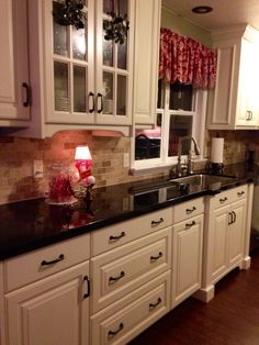 Off white cabinets, Brazilian marron cohiba granite counter tops, dark wood floor. My kitchen design.