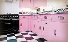 I want my kitchen like this. Except cherry red, not pink, with aqua accents.