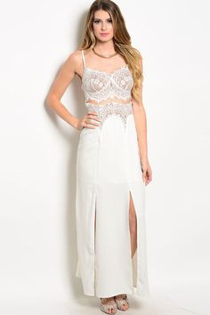 You'll definitely stand out in any formal event with this incredibly sexy and feminine maxi dress. It boasts beautiful eyelash lace detailing along the bust and waist area. There are two front slits t