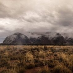 Tourists to Uluru are treated to the unusual sight of rain splashing down the side of the monolith.