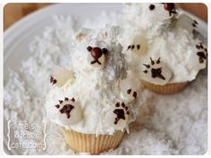 Polar Bear Cup cake- blog originally from is blocked as spam.    Looks like you will need coconut, white smarty, chocolate and white gumdrops