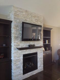 Elite tv above brick fireplace ideas for 2019 Tv Above Fireplace, Fireplace Hearth, Home Fireplace, Fireplace Remodel, Modern Fireplace, Fireplace Surrounds, Fireplace Design, Fireplace Ideas, Stacked Stone Fireplaces