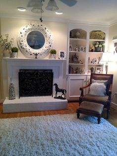 Family room, with cream shag rug. Paint color is Rafia