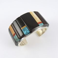Cuff | Edison Cummings (Navajo).  Sterling Silver with a Cobbled Inlay Design using Number Eight Turquoise, Coral, Ebony, and Fossilized Ivory.