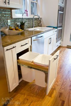 http://www.modelhomekitchens.com/category/Garbage-Can/ 7 Really Cool Kitchen Organizers I have this trash storage, I love it!!!!