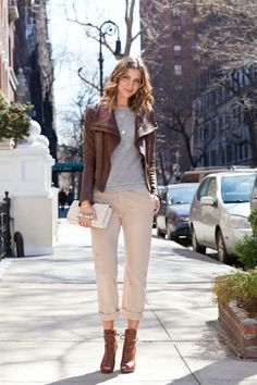 gray crew neck tee + cuffed khakis + cropped leather jacket