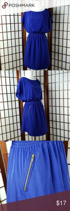 """ONE CLOTHING Blouson Dress Size L Pre-owned gently worn  ONE CLOTHING SIZE LARGE Blouson Dress style  Dolman/Batwing Sleeve  Zip pockets and zip in the back for closure  Solid pattern  Shade of blue color  (bluepurple) Made of 100% polyester   Measurements Approximate  Pit to pit 20""""  Shoulder to hem 34"""" Waist 28-36"""" stretchable one clothing Dresses"""