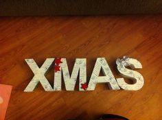 Wrapping paper on 3D letters with final touches