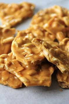 Peanut Brittle by Noshing Wtih The Nolands (Small) Candy Recipes, Sweet Recipes, Holiday Recipes, Dessert Recipes, Holiday Foods, Dessert Bars, Christmas Recipes, Homemade Peanut Brittle, Microwave Peanut Brittle