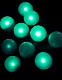"Fairy Berries™ Teal Green (10 for 18.00) Totally submersible. They fade in and out very slowly, creating a moving firefly effect which can be absolutely breathtaking.  Place these small 3/4"" diameter LED balls everywhere around your party venue. On the lawn, in the garden, hanging from trees, shrubs and ceilings. Lasts 20+ hours. Sold in sets of 10.  Also available in yellow and white..."