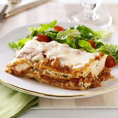 Makeover Traditional Lasagna Recipe -I've never been quick to pass along my special recipes, but this one is so good that it's become our family's Christmas Eve tradition! —MICHELLE BEHAN, LITTLETON, COLORADO