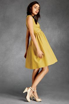 Full-skirted taffeta, ruched at the waist, bowed at the shoulders and topstitched at the hem.