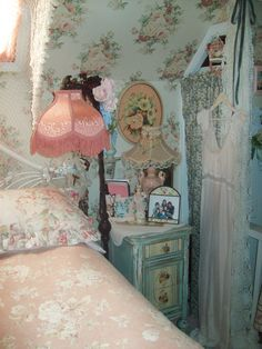 Vintage Shabby Attic Bedroom---so quaint and COZY!  Love the floral wallpaper!