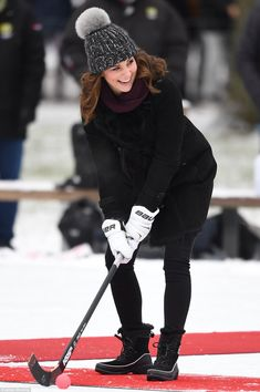 The Duchess of Cambridge got competitive with her husband on a 'bandy hockey' rink today during their first engagement of a tour to Sweden and Norway