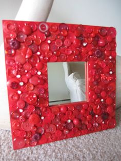 Lots of textures and freedom! Could do this with a mirror or a plain picture frame. The kids could even take their own pictures to put in it!