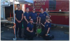 Coco at the 2015 Margate National Night out. She is the mascot for the Margate CERT team and posing with some law enforcement explorers. A good therapy dog loves people.