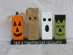 Wood Block Halloween Decoration with Pumpkin, Mummy, Ghost, and Frankenstein.
