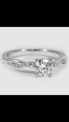 My dream ring, but replace the princess cut with a tear drop or oval diamond.