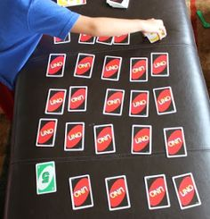 We've been playing this Make 10 Game with our Uno cards that I found over at E is for Explore.  Directions: Using only the cards 1-9, shuffle and make a 5 x